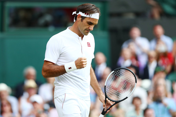 Federer pumps his fist during his win over Struff. Photo: Matthew Stockman/Getty Images