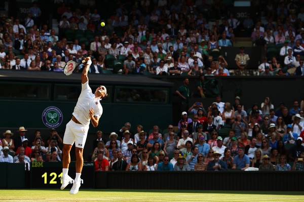Roger Federer serves on Centre Court during his round three win. Photo: Matthew Stockman/Getty Images