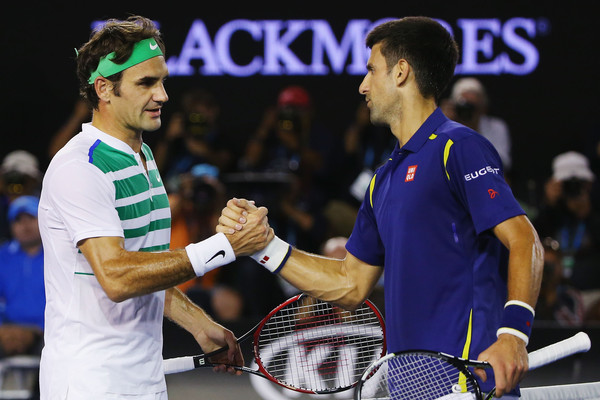 Federer (left) and Djokovic shake hands after their semifinal. Photo: Michael Dodge/Getty Images
