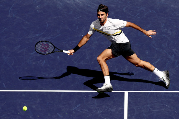 Roger Federer lunges for a volley during his semifinal battle with Coric. Photo: Matthew Stockman/Getty Images