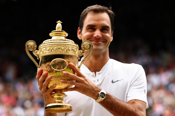 Federer holds his eighth Wimbledon trophy in July. Photo: Clive Brunskill/Getty Images