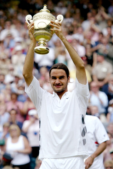 Federer hoists his trophy after winning Wimbledon in 2003. Photo: Cynthia Lum/WireImage