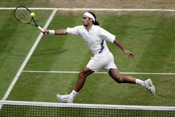 Federer lunges for a volley during his semifinal win. Photo: Phil Cole/Getty Images