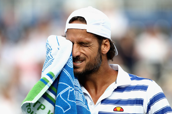 Lopez makes use of the towel during his victory (Photo: Clive Brunskill/Getty Images Europe)