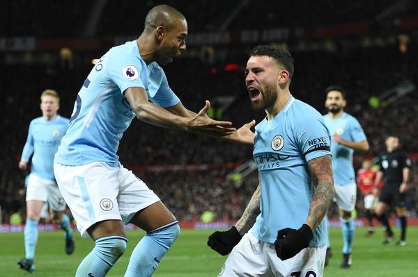 Otamendi celebra un gol junto a Fernandinho. Foto: Getty Images