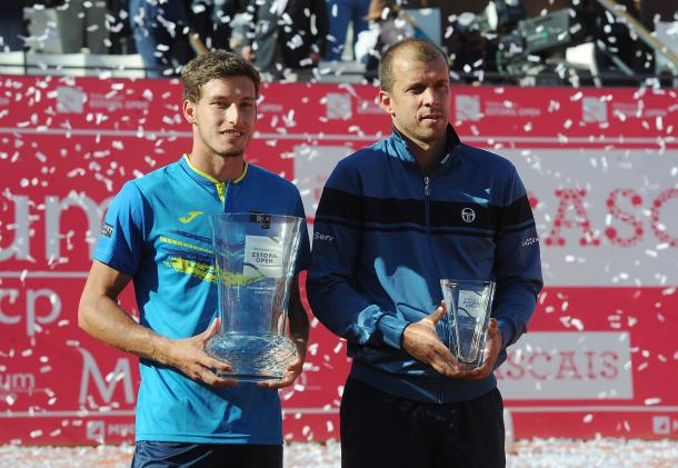 Pablo Carreno Busta and Giulles Muller with their titles. (Photo by Millennium Estoril Open)