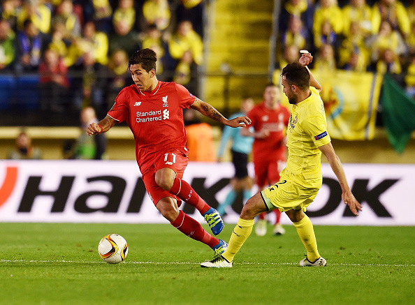 Roberto Firmino dribbles past Mario as the Brazilian looks to create a chance for Liverpool in the first leg of the Europa League semi-final. (Getty)