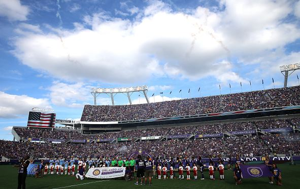 The national anthem is performed during an MLS soccer match between the New York City FC and the Orlando City SC at the Orlando Citrus Bowl on March 8, 2015 in Orlando, Florida. This was the first game for both teams and the final score was 1-1. (Photo by Alex Menendez/Getty Image