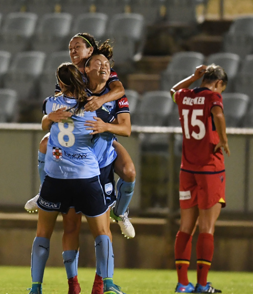 Sydney FC forward Caitlin Ford is burried by teammates after scoring the game-winning goal against Adelaide United. | Photo: Mark Brake - Getty Images