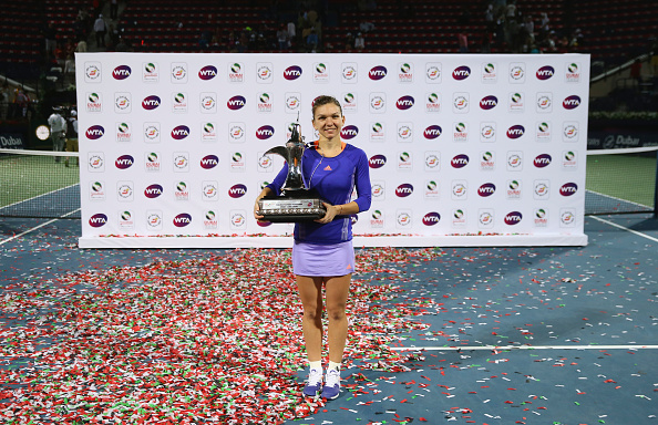 Simona Halep poses with the trophy after winning the tournament in 2015 (Getty/Francois Nel)