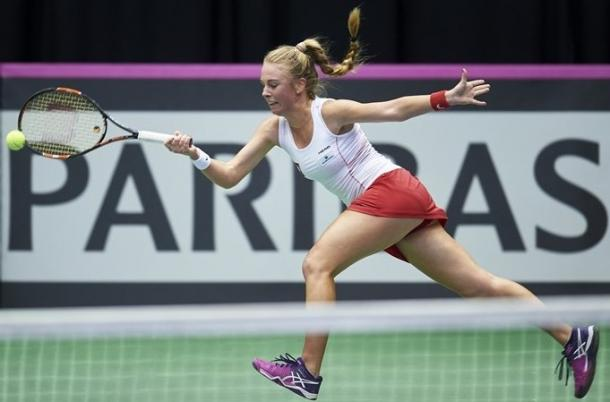 Magdalena Frech stretches for a forehand during her comeback victory. Photo: Adam Nurkiewicz/Fed Cup