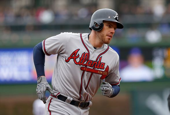 Freddie Freeman of the Atlanta Braves rounds the bases after hitting a home run in the fourth inning against the Chicago Cubs at Wrigley Field on April 29, 2016 | Dylan Buell - Getty Images