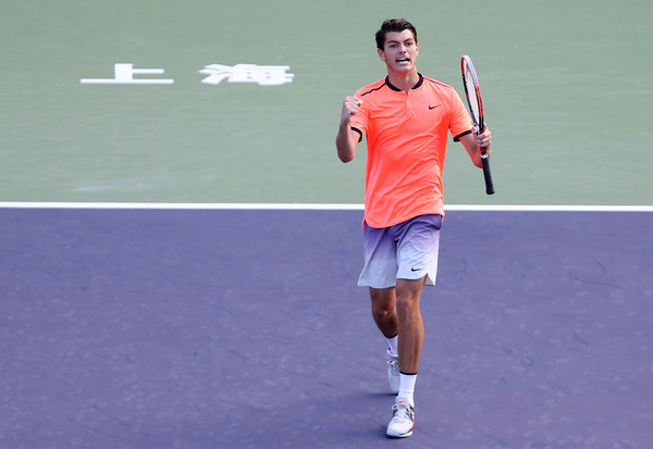 Taylor Fritz celebrates winning a point during his first round win. Photo: Zhong Zhi/Getty Images