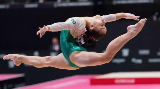 Flavia Saraiva perfroms on the balance beam at the 2015 World Artistic Gymnastics Championships in Glasgow/Getty Images
