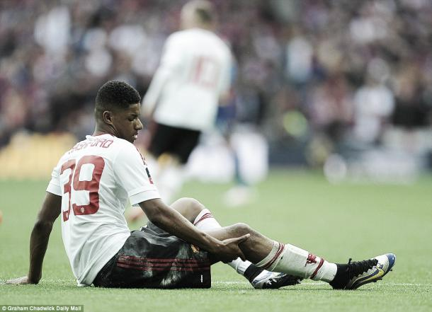 Above: Marcus Rshford down injured on the Wembley turf in Manchester United's 2-1 win over Crystal Palace | Photo: Graham Chadwick / Daily Mail