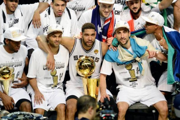 Manu Ginobili, Tony Parker and Tim Duncan celebrate their last championship victory with the Spurs in 2014. Photo Garrett Ellwood/Getty Images