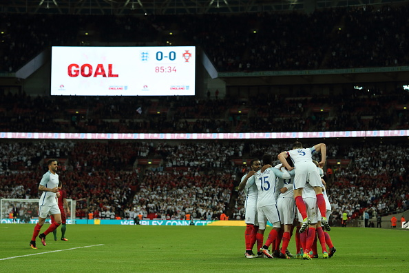 England celebrate in their final warm-up game - Portugal | Photo: Matthew Ashton/AMA