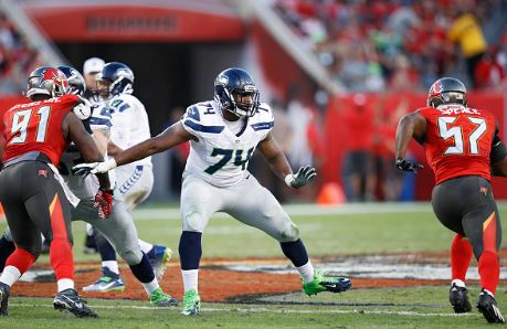 George Fant (74) was point in at left tackle after not playing football since he was in eight grade | Source: Joe Robbins - Getty Images