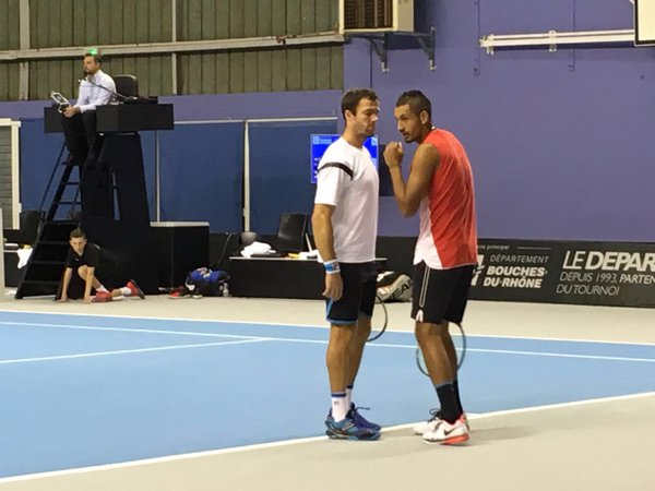 Gabashvili (left) and Kyrgios discuss strategy during their match (Photo: Open 13)