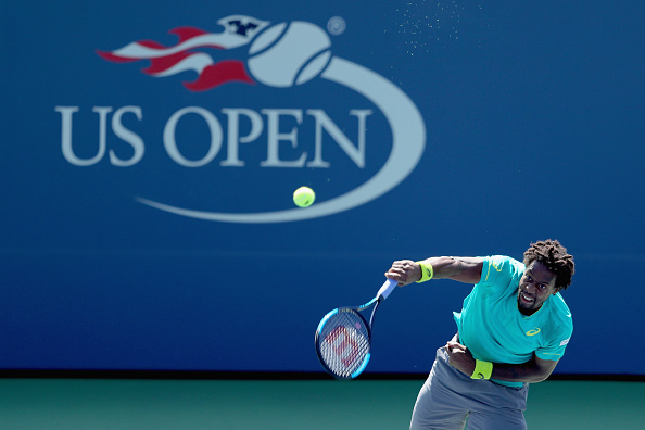 Gael Monfils serving up a two-set lead (Photo: Richard Heathcote/Getty Images)