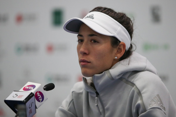 Garbine Muguruza speaking at her post-match press conference in Beijing, where she had to retire in her first round match | Photo: Lintao Zhang/Getty Images Asia Pacific
