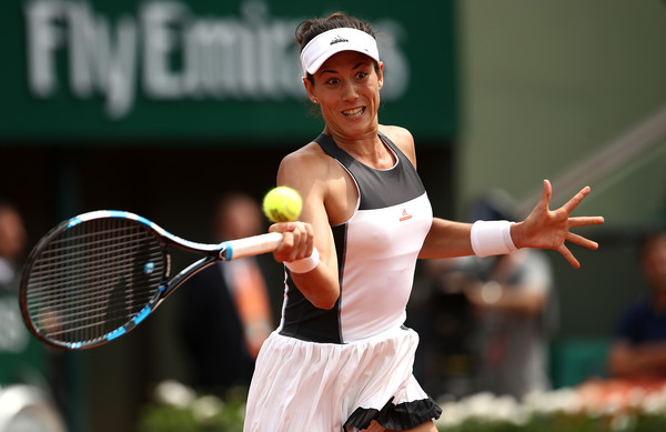 Garbiñe Muguruza hits a forehand during her first-round victory over Francesca Schiavone at the 2017 French Open. | Photo: Julian Finney/Getty Images