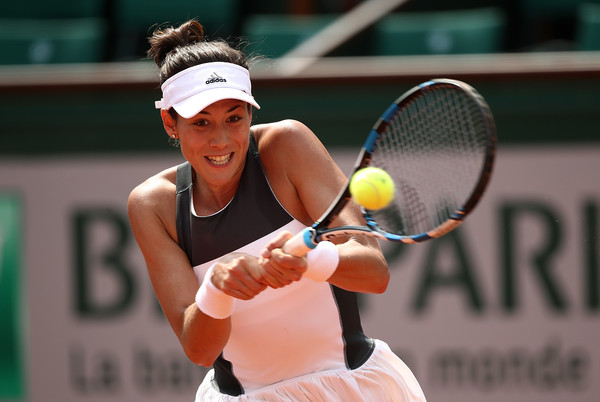 Garbiñe Muguruza hits a backhand during her first-round victory over Francesca Schiavone at the 2017 French Open. | Photo: Julian Finney/Getty Images