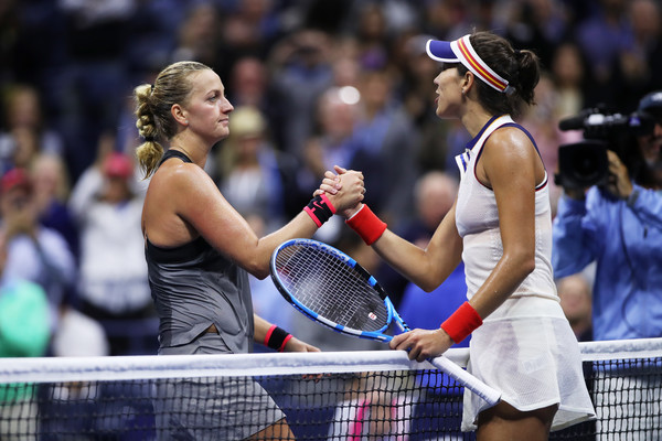 The players meet at the net for a handshake after the match | Photo: Matthew Stockman/Getty Images North America