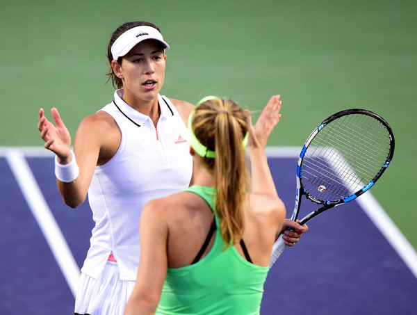 Garbiñe Muguruza and Elina Svitolina shake hands after their fourth-round match at the 2017 BNP Paribas Open. | Photo: Harry How/Getty Images