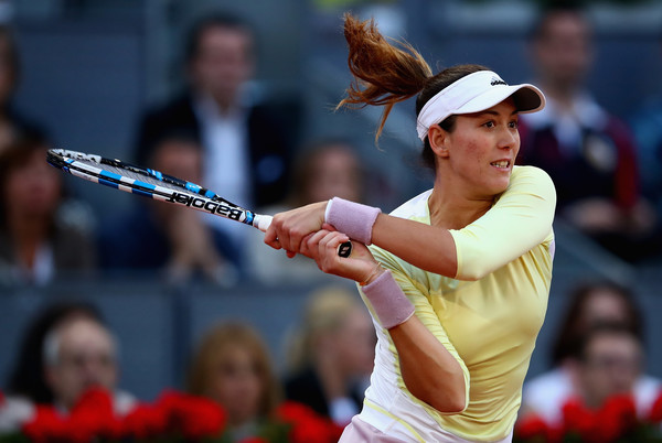Garbiñe Muguruza follows through on a backhand during her second round match at the 2016 Mutua Madrid Open, a match she would go on to lose. | Photo: Clive Brunskill/Getty Images Europe