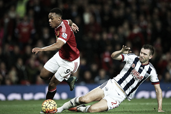 McAuley makes a sliding tackle against Anthony Martial (Getty images)