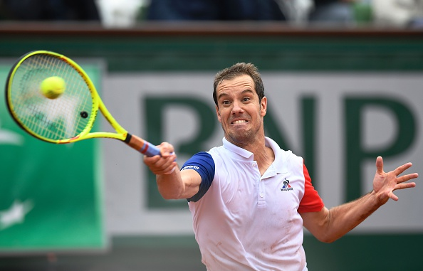 Richard Gasquet lunges for a forehand. Photo: Miguel Medina/AFP/Getty Images