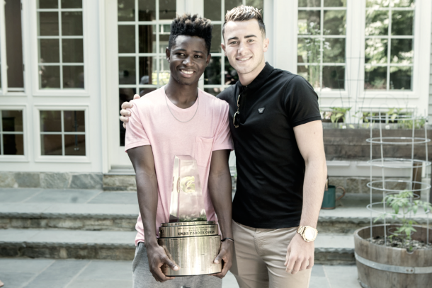 Jack Harrison takes a picture with Umar as he holds his new award. | Photo: Gatorade