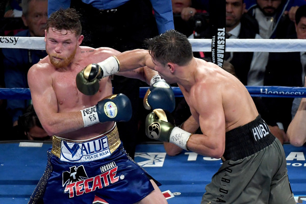 Gennady Golovkin throws a punch at Canelo Alvarez during their WBC, WBA and IBF middleweight championionship bout. |Source: Ethan Miller/Getty Images North America|