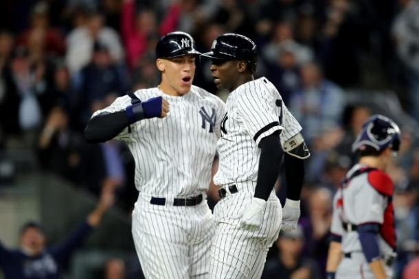 Didi Gregorius #18 of the New York Yankees celebrates with Aaron Judge #99. |Photo by Elsa/Getty Images|