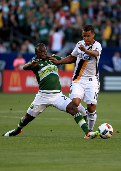 Giovani Dos Santos is challenged by Diego Chara Image Courtesy of Sean M. Haffey/Getty Images North America