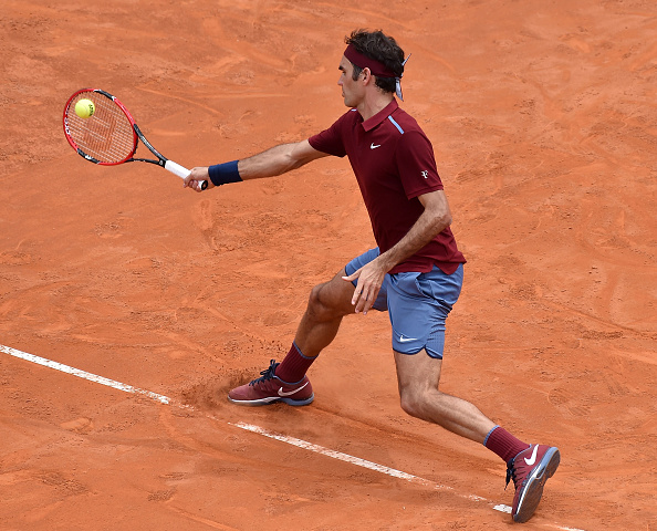 Federer slides into a forehand shot. Credit: Giuseppe Bellini/Getty Images