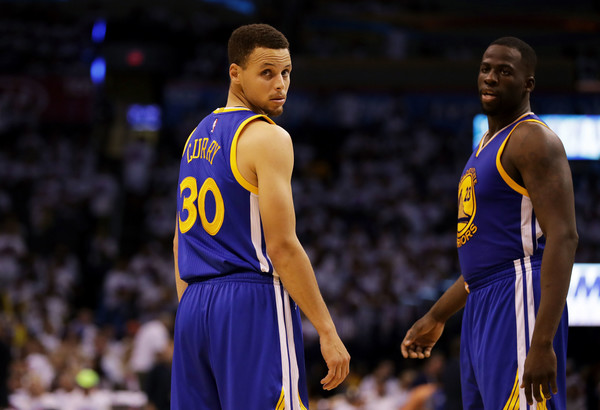 Golden State Warriors' guard Steph Curry (30) and forward Draymond Green (23) have their backs against the wall, down 3-1 in the series. Photo: