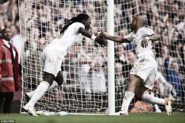 Above: Bafetimbi Gomis celebrates his injury-time goal in Swansea's 4-1 win over West Ham | Photo: Reuters