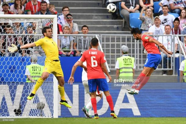 Giancarlo Gonzalez heads the ball as Serbia's goalkeeper Vladimir Stojkovic attempts to save it. Source | Getty Images.
