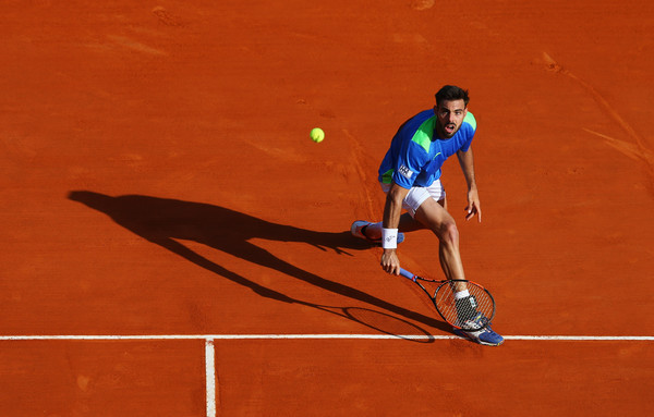 Marcel Granollers slides into a backhand. Photo: Michael Steele/Getty Images