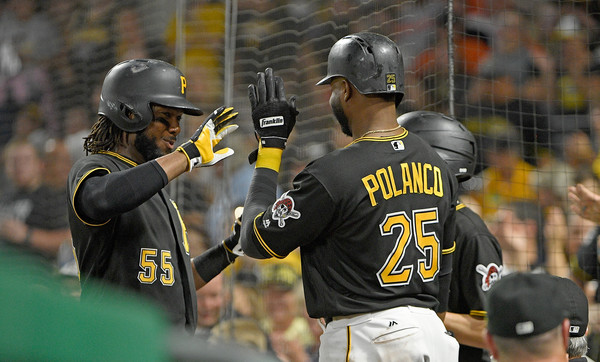 Josh Bell #55 of the Pittsburgh Pirates high fives with Gregory Polanco #25 after hitting a two run home run. |Sept. 26, 2017 - Source: Justin Berl/Getty Images North America|