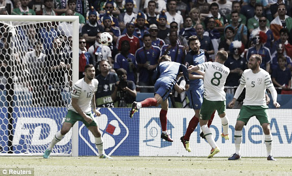 Above; Antoine Griezmann heading home in France's 2-1 win over Ireland | Photo: Reuters