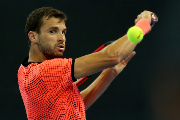 Grigor Dimitrov hits a backhand slice during his second-round match against Lucas Pouille at the 2016 China Open. | Photo: Emmanuel Wong/Getty Images