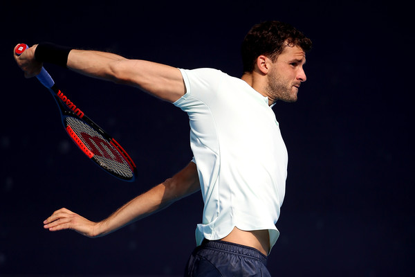 Grigor Dimitrov hits a backhand | Photo: Emmanuel Wong/Getty Images AsiaPac