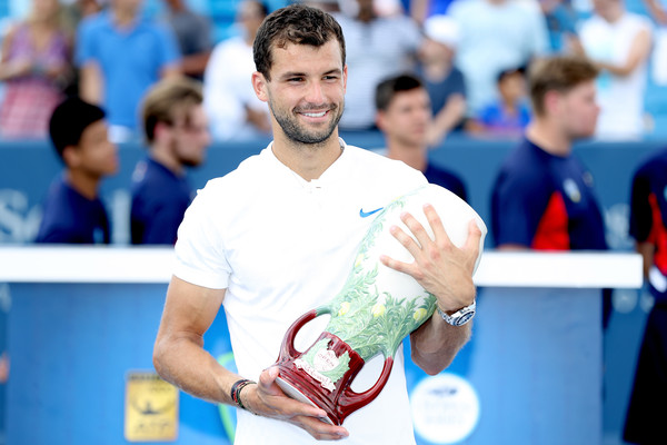 Dimitrov poses with the famous vase at the Western and Southern Open (Matthew Stockman/Getty Images North America)
