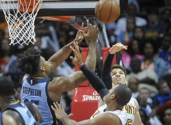 Lance Stephenson attempts a rebound for the Grizzlies against Hawks Kyle Korver and Al Horford.   John Amis AP Photo