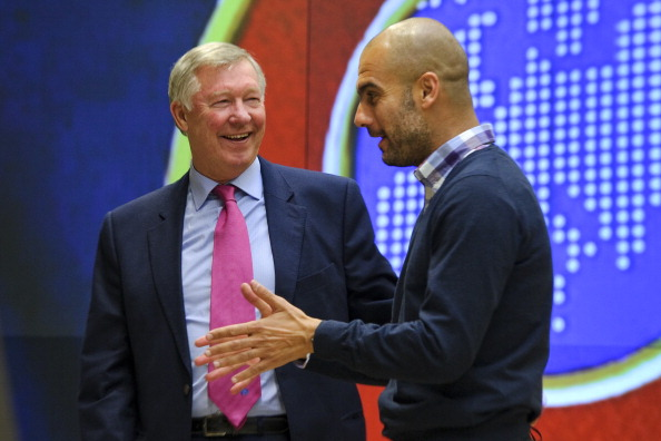 Guardiola has a good relationship with United director Sir Alex Ferguson | Photo: Fabrice Coffrini/AFP