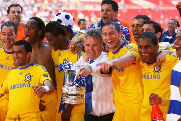 Guus Hiddink celebrates with Chelsea players after 2009 FA Cup victory. | Getty Images