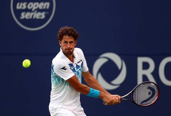 Robin Haase lines up a backhand during his upset win over Shapovalov. Photo: Getty Images